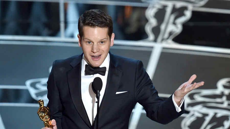 Graham Moore en los premios Oscar 2015.