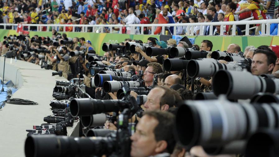 muchos fotografos