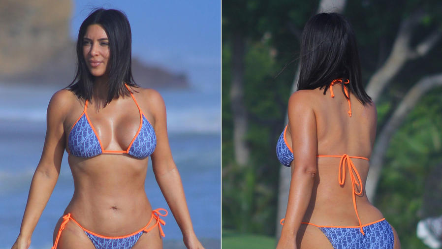 Kim Kardashian en bikini azul con bordes naranja
