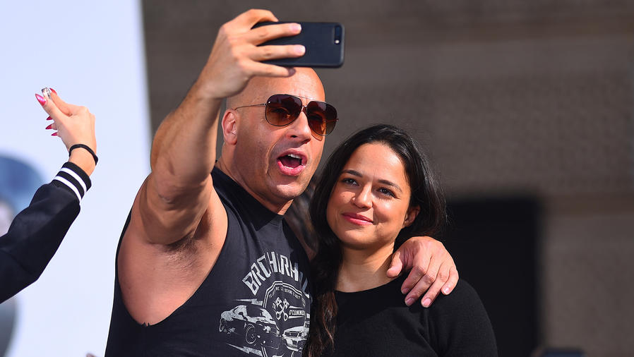 Michelle Rodriguez and Vin Diesel taking a selfie