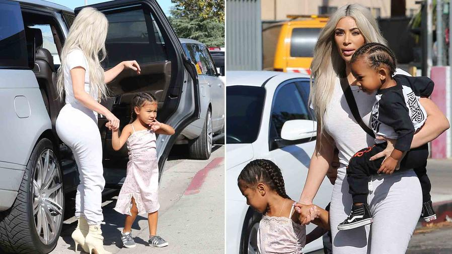 Kim Kardashian Steps Out with North and Saint for Ice Skating