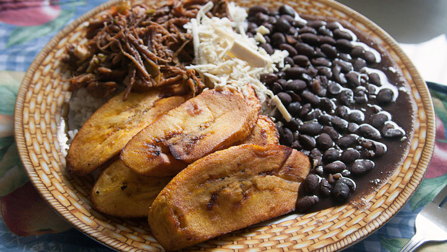 Venezuelan cuisine: Pabellón Criollo, Rice, Shredded beef, fried plantain, and stewed black beans