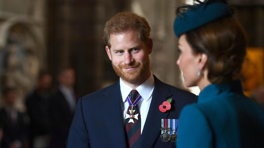 El príncipe Harry con Kate Middleton
