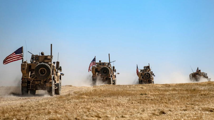 A US military convoy takes part in joint patrol with Turkish troops in the Syrian village of al-Hashisha on the outskirts of Tal Abyad town along the border with Turkish troops, on September 8, 2019.