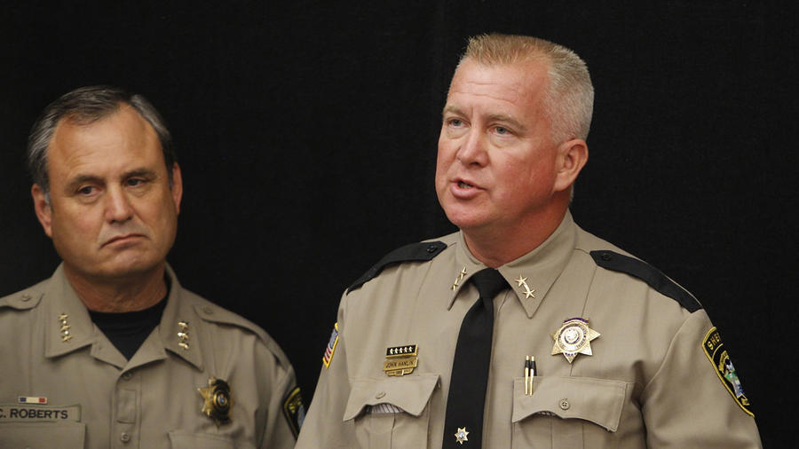 Sheriff John Hanlin speaks at a news conference in Roseburg, Oregon