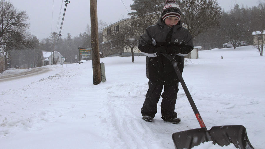 Kaiden Rogers shovels snow from his driveway on Tuesday, Nov. 12, 2019 in Marshfield, Vt