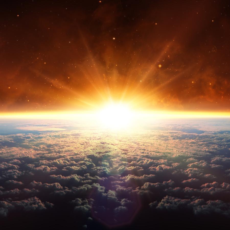Planeta Tierra y sol asomándose