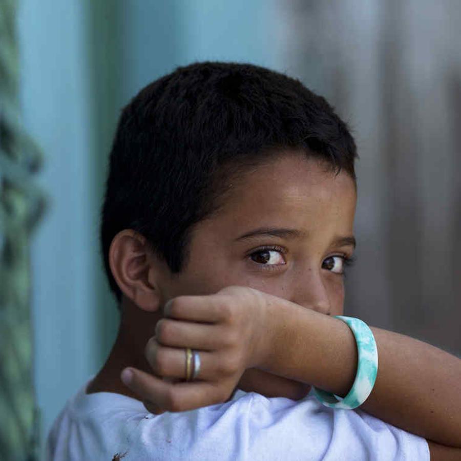 Foto de archivo: Un menor inmigrantes originario de El Salvador en un refugio mexicano.