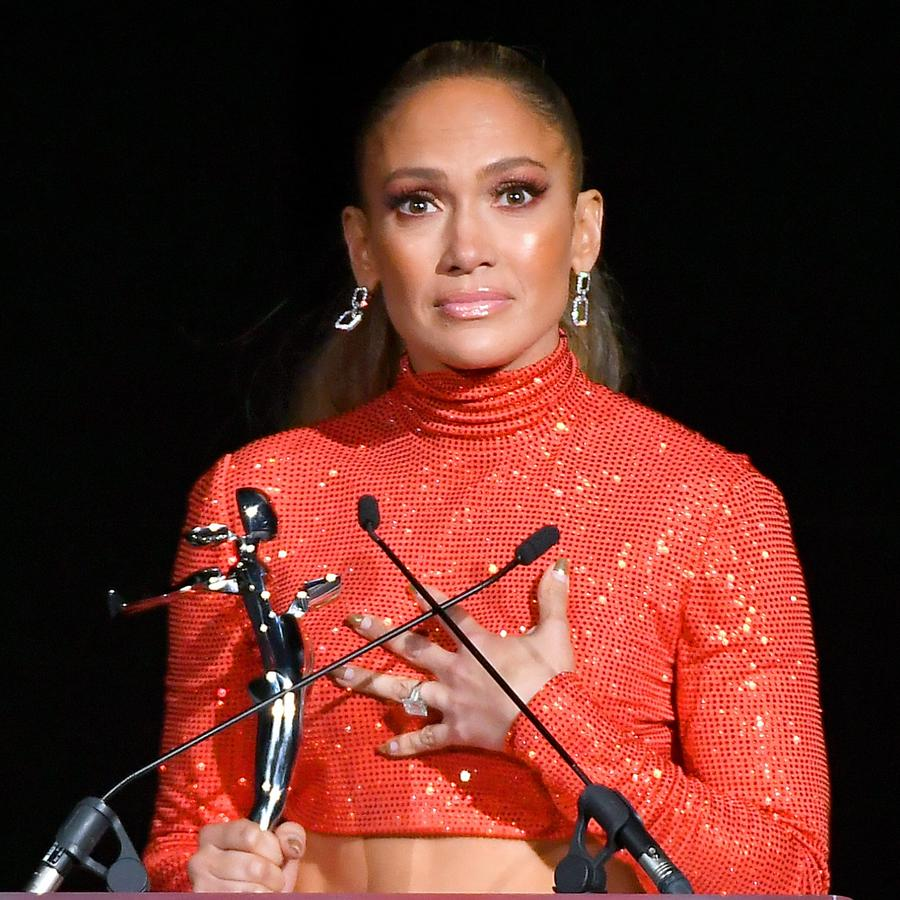 Jennifer Lopez gives speech in red-orange crop top