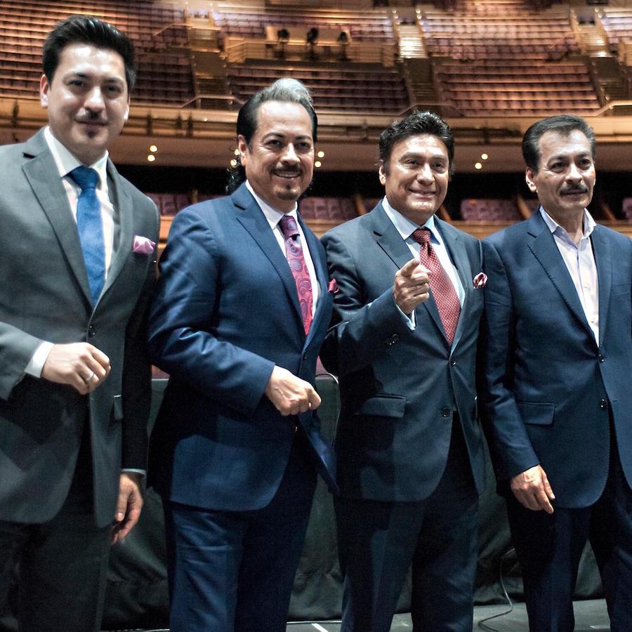 Los Tigres del Norte pose during a press conference