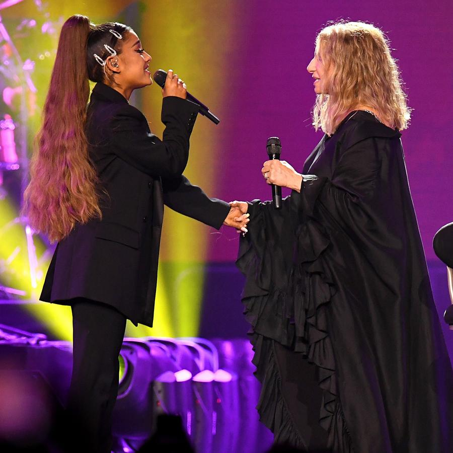 Ariana Grande and Barbara Streisand perform together.