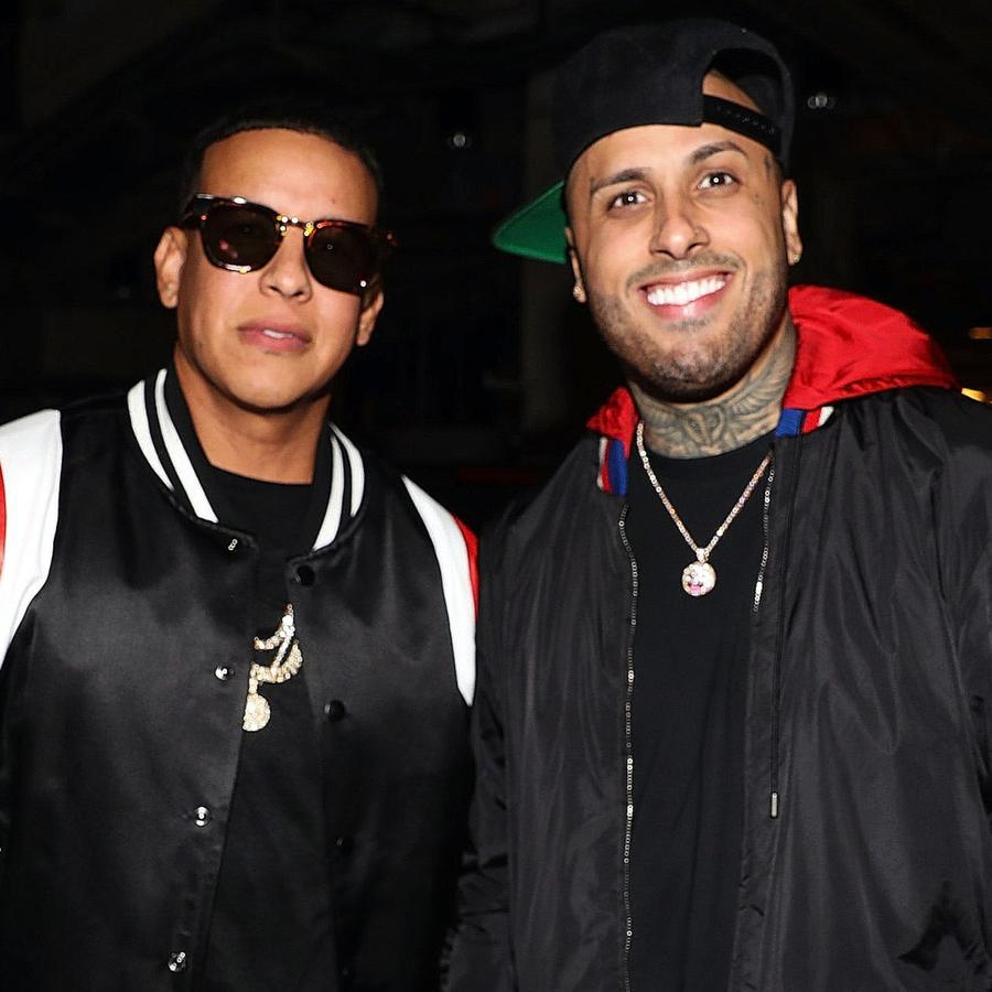 Daddy Yankee and Nicky Jam posing for a photo together