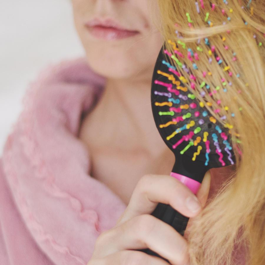 mujer caida de cabello