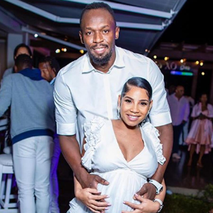 Usain Bolt y su esposa posando