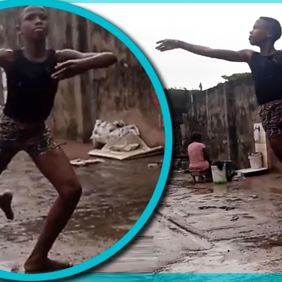 niño nigeriano baile lluvia