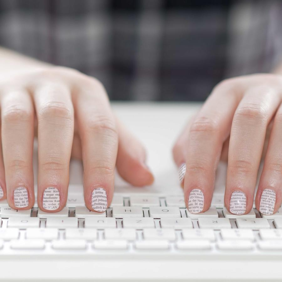 Secretary, hands of woman with varnished nails on tastature