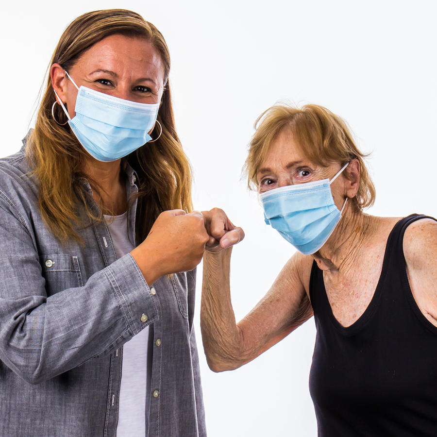 Mother & Daughter Fist Bump Greeting During Corona Virus Pandemic