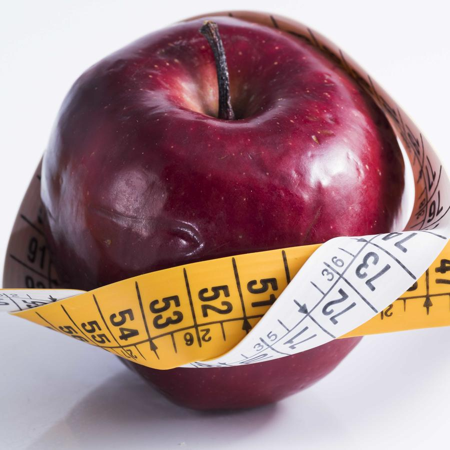 Manzana con metro alrededor