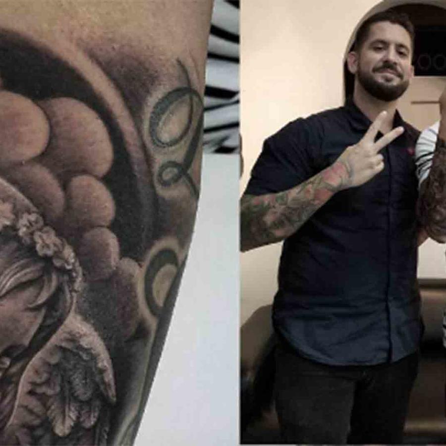 Wisin tatuaje