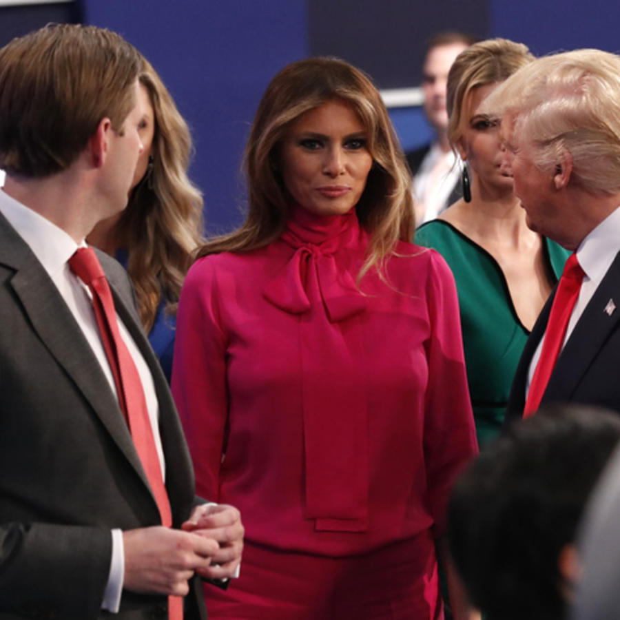 Republican U.S. presidential nominee Donald Trump talks with family at the conclusion of the debate with Democratic U.S. presidential nominee Hillary Clinton in St. Louis