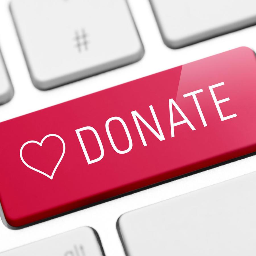 Teclado de computadora con botón Donate