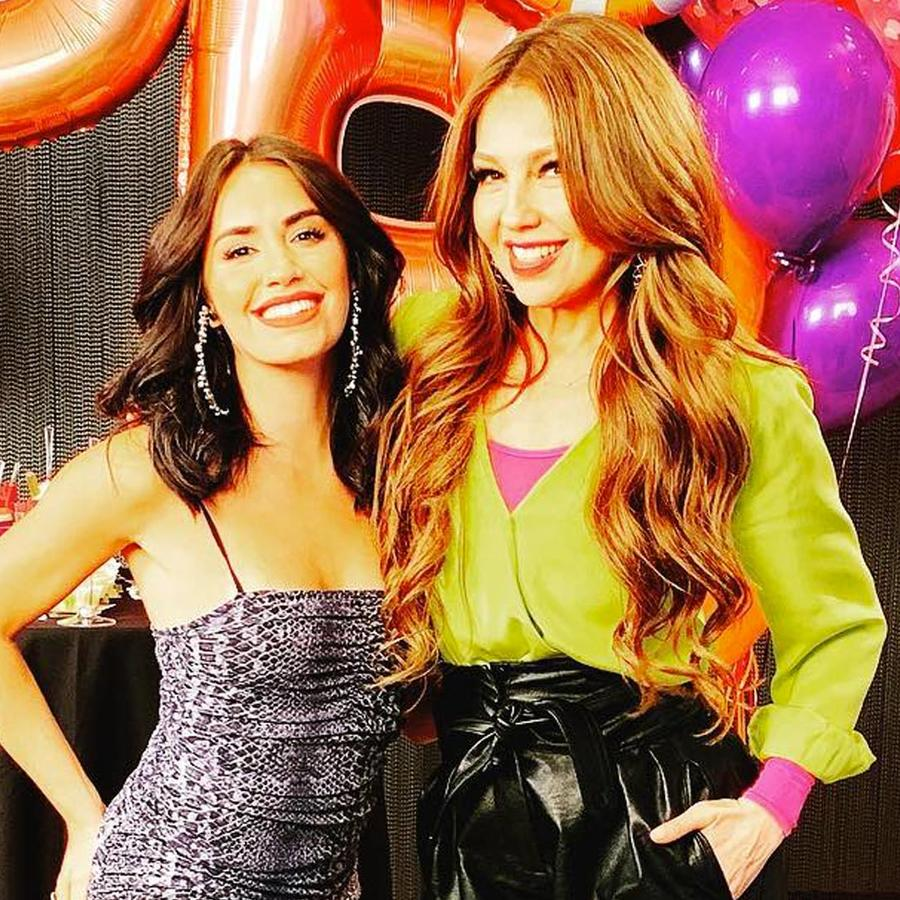 Lali con Thalía en una fiesta