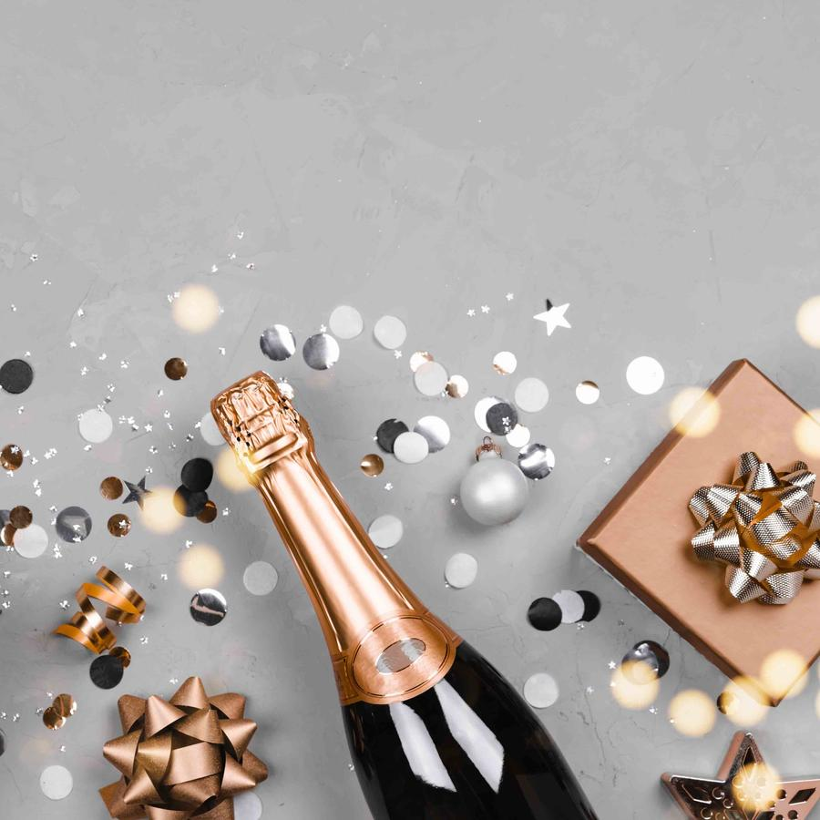 Flat lay composition of champagne, gift box and confetti.