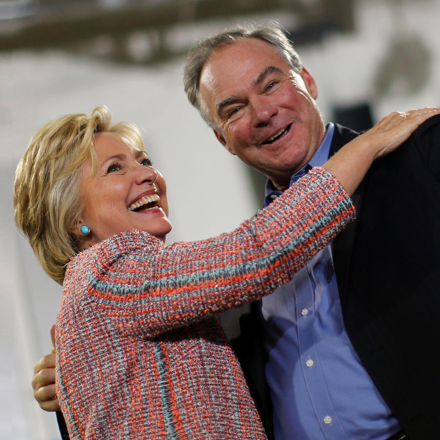 Democratic U.S. presidential candidate Hillary Clinton and U.S. Senator Tim Kaine (D-VA) react during a campaign rally at Ernst Community Cultural Center in Annandale, Virginia, U.S.
