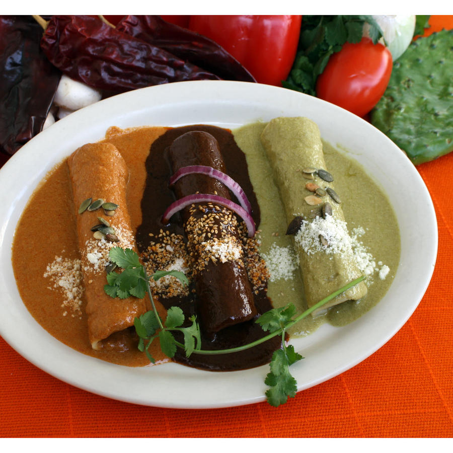 Three moles enchiladas smothered in mole poblano