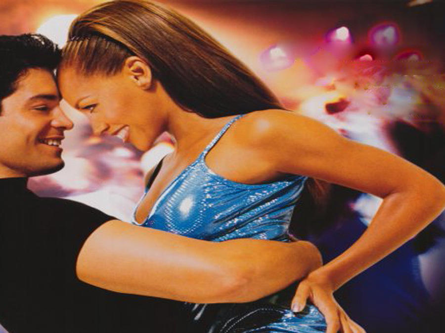 Chayanne and Vanessa Williams dancing in ascene of the movie Dance With ME