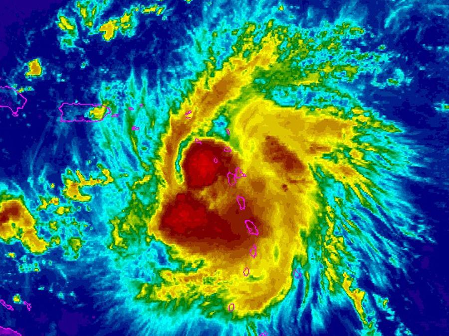 Tropical Storm Erika is seen in the Caribbean Ocean in a NOAA GOES-East enhanced satellite image