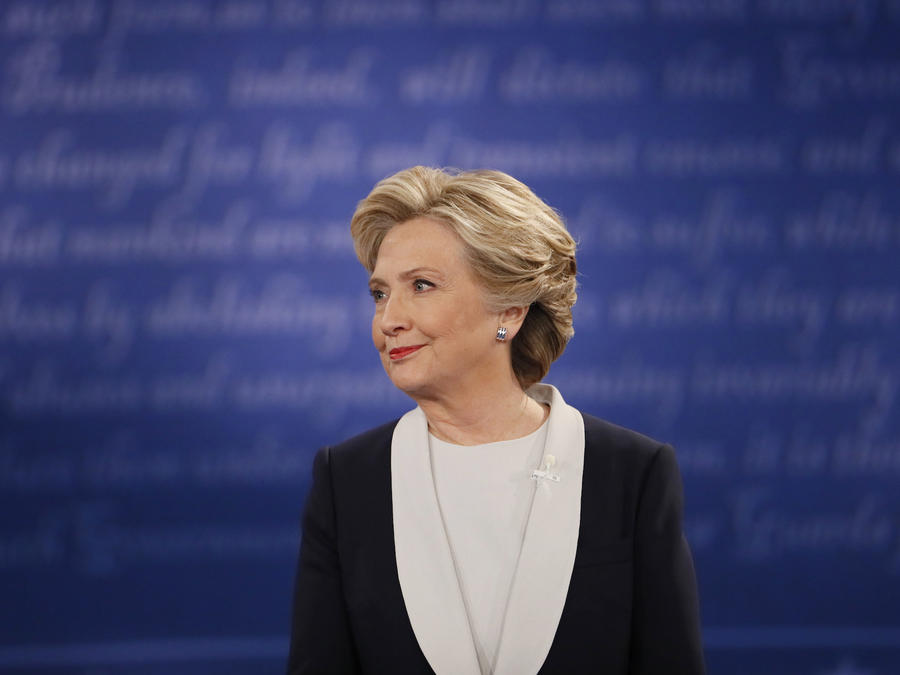 Democratic U.S. presidential nominee Hillary Clinton listens during their presidential town hall debate with Republican U.S. presidential nominee Donald Trump at Washington University in St. Louis