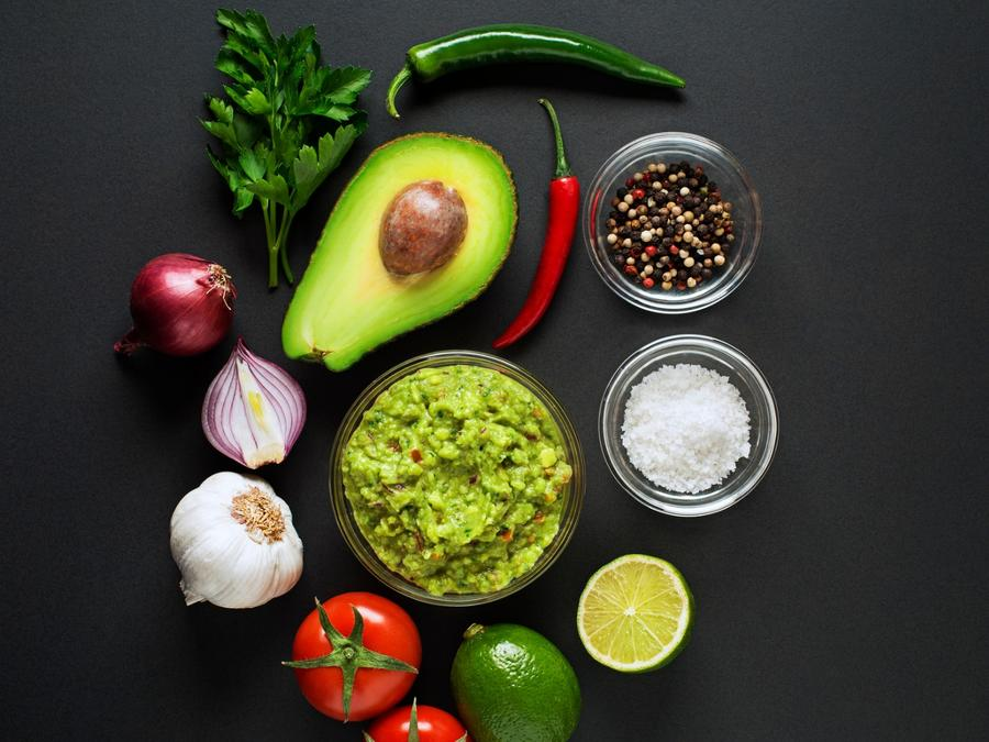 Guacamole preparation on a table.