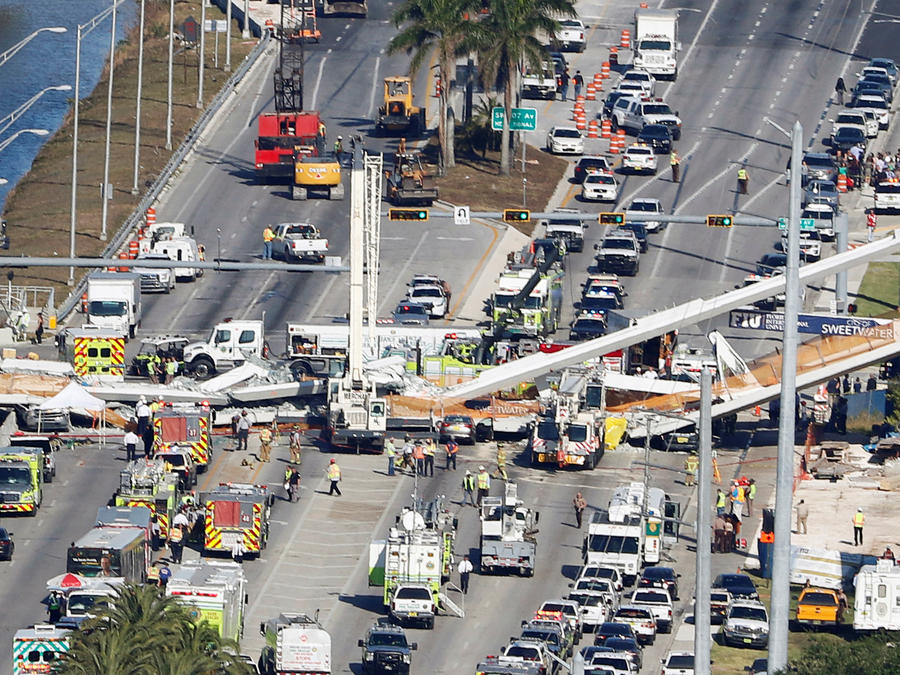 Aerial view shows a pedestrian bridge collapsed at Florida International University in Miami