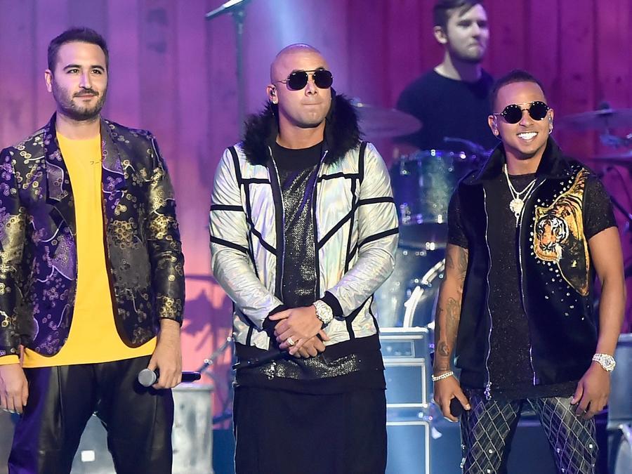 Reik, Wisin, and Ozuna onstage at the 2018 Billboard Latin Music Awards