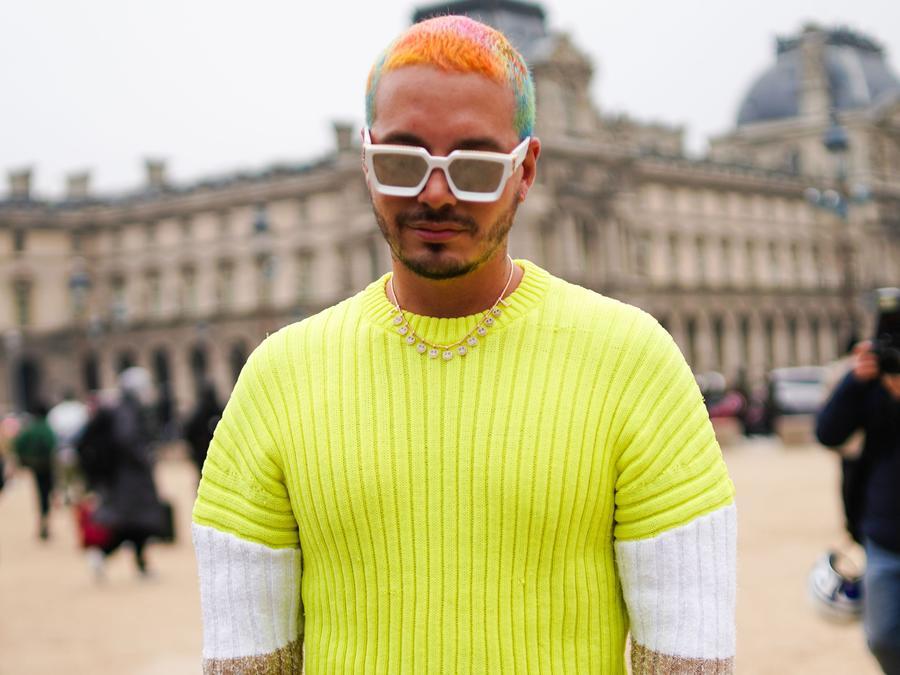 J Balvin wearing Neon Yellow sweater and white sunnies.