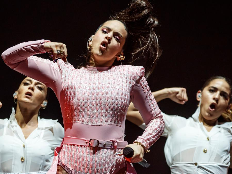 Rosalia performs live wearing a pink outfit