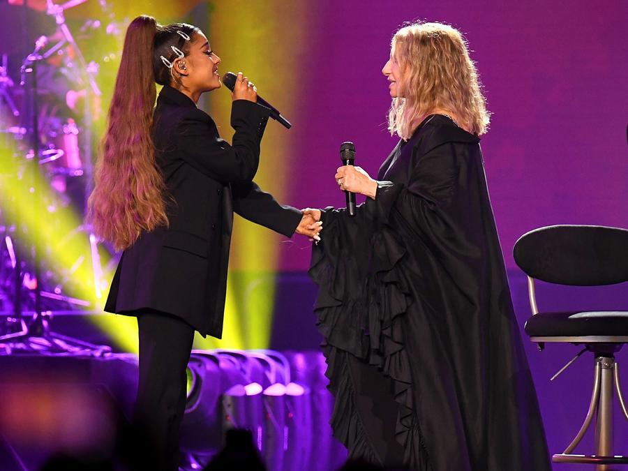Ariana Grande and Barbara Streisand perform together.