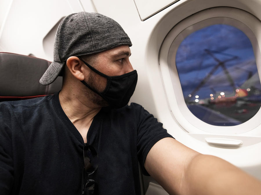 Man on plane looking out the window