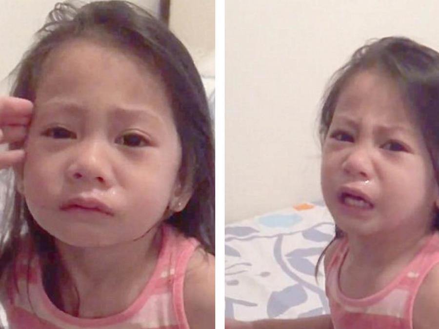 Niña llorando desconsoladamente