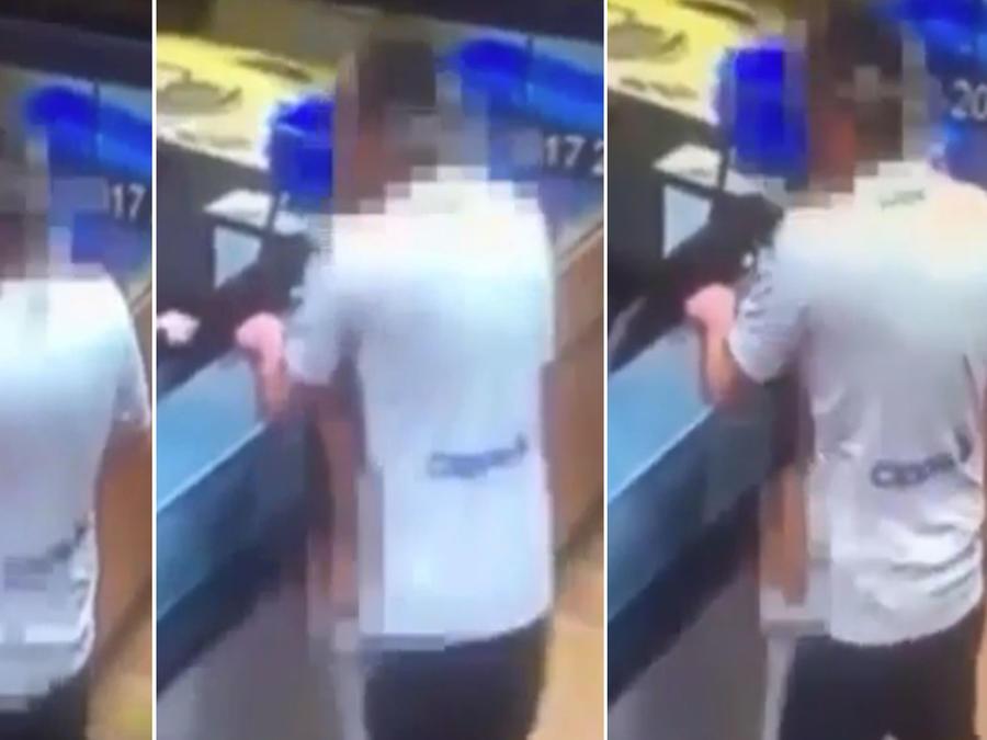 Captan a una pareja teniendo sexo en el mostrador de una pizzería (VIDEO)