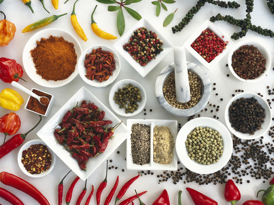 Spices on white background, elevated view