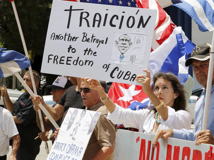 Protesters demonstrate against the reopening of the U.S. embassy in Havana, in the Little Havana neighborhood in Miami