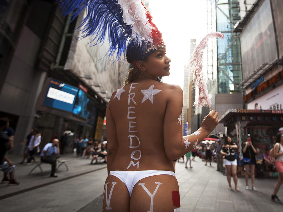 Saira Nicole, who poses for tips wearing body paint and underwear, poses for a portrait in Times Square in New York