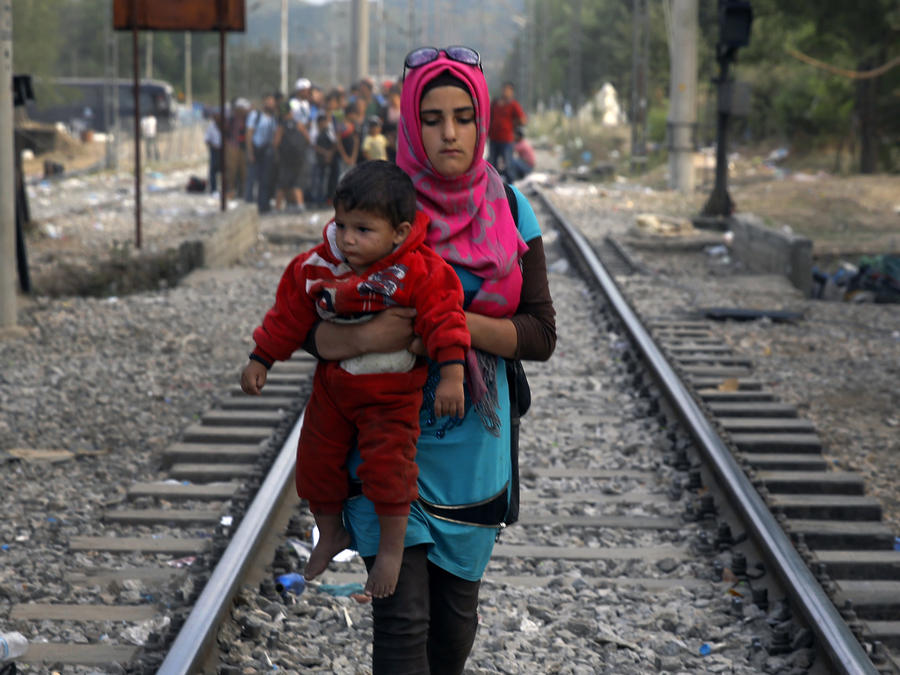 A Syrian refugee walk on rail tracks near Greece's border with Macedonia