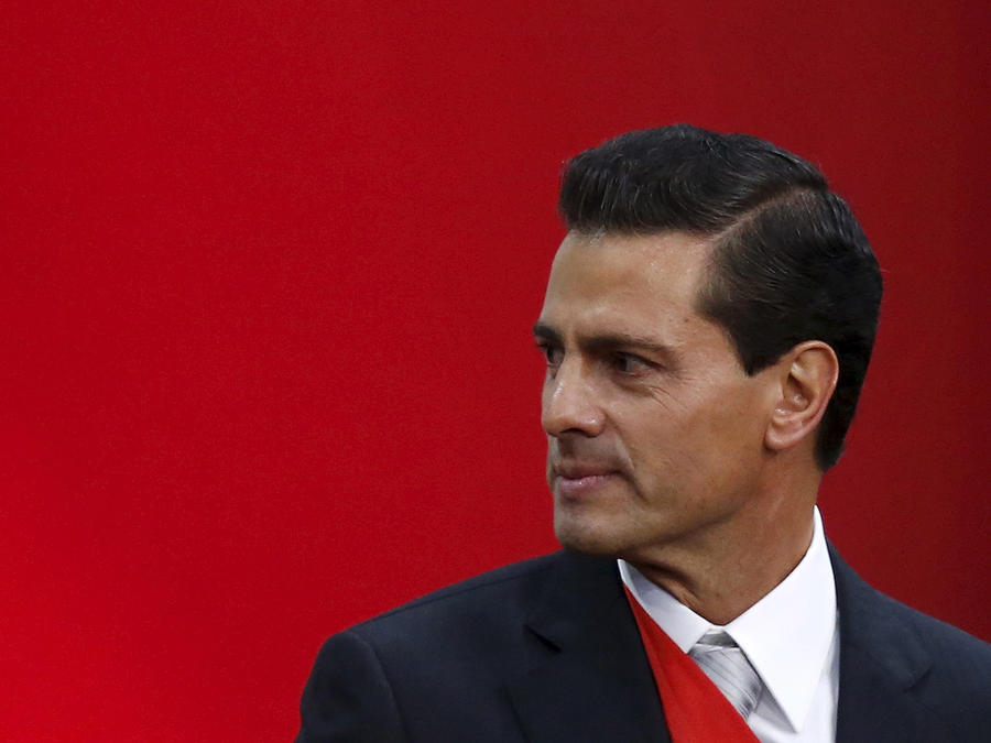 Mexico's President Enrique Pena Nieto is seen after addressing the audience during his third State of the Union address at the National Palace in Mexico City