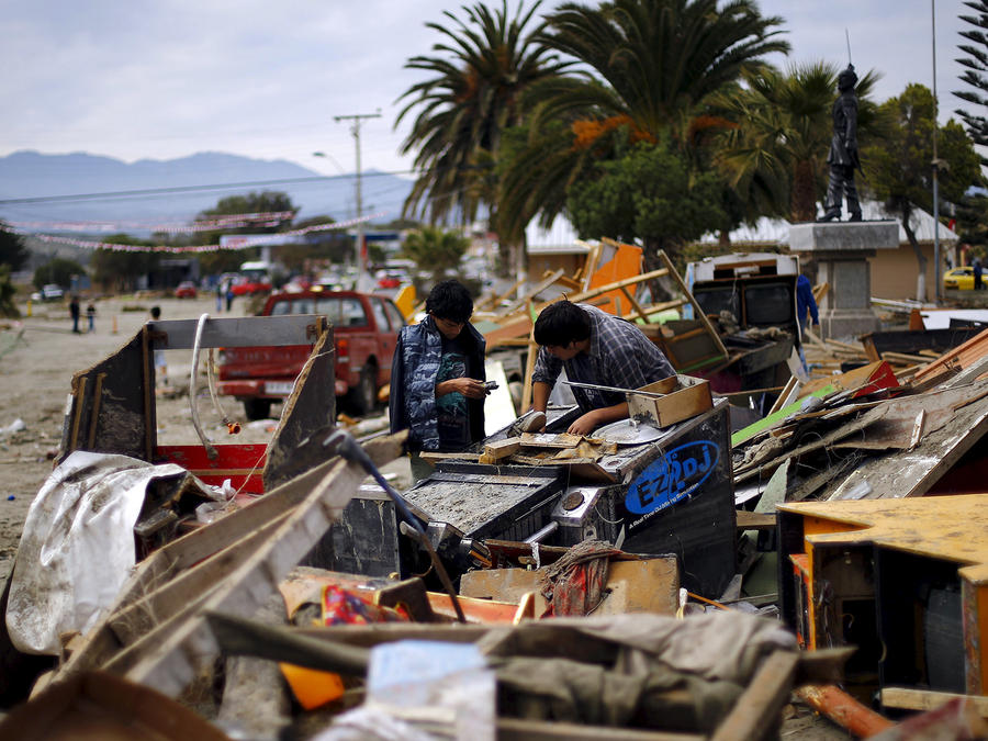 Residents look among the debris after an earthquake hit areas of central Chile, in Tongoy town