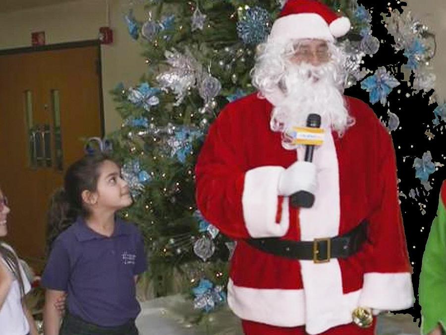 santa y elf con niños