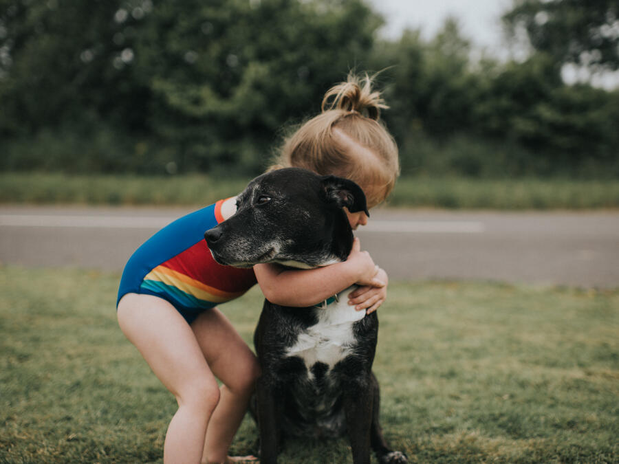 Girl hugs Dog