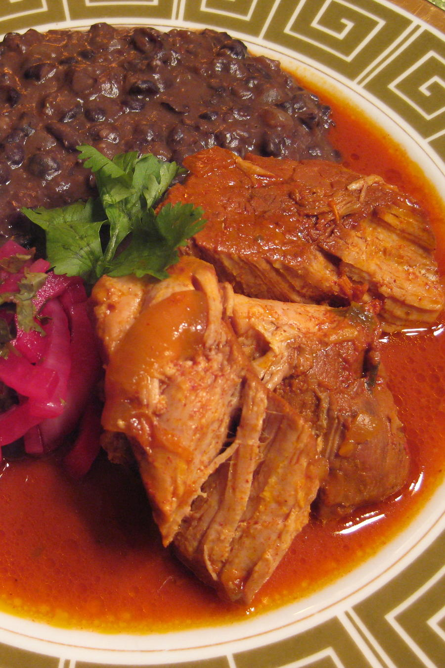 Pork shoulder marinated with achiote and braised in achiote paste and bitter orange juice